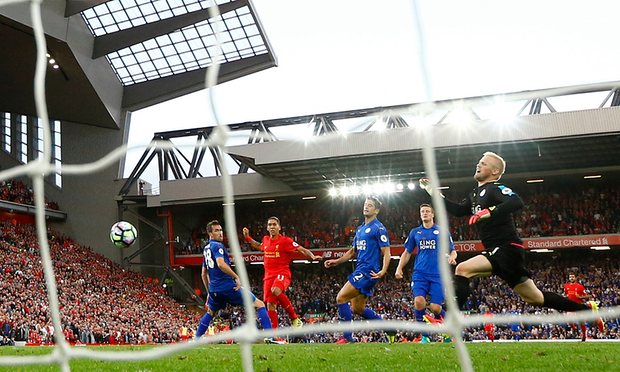 Liverpool's Roberto Firmino scores their fourth goal.